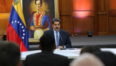 President Nicolas Maduro delivers a press conference to local and international media at the government's seat in Caracas.