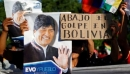 "Supporters of Bolivia's ousted President Evo Morales hold a placard that reads ""Down with the coup in Bolivia"" as they gather outside the U.S. embassy in Buenos Aires to protest against the U.S. government, in Buenos Aires, Argentina November 22, 2019"