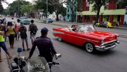 A vintage car with tourists in Havana, Cuba, Oct. 2, 2019.