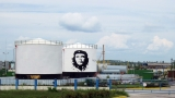 "FILE PHOTO: A painted image of Ernesto ""Che"" Guevara on a fuel container at an electricity generation plant in Santa Clara, Cuba"
