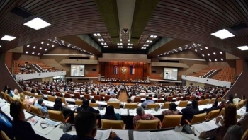 Cuban lawmakers attend a parliamentary session at the country's National Assembly in Havana.