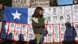 A Chilean flag featuring victims of the dictatorship on the anniversary of the coup that brought Pinochet to power, 2003.